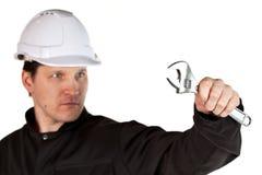Handyman wearing uniform and hardhat Stock Photos