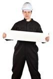 Handyman wearing uniform and hardhat Royalty Free Stock Image