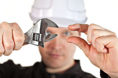 Handyman wearing uniform and hardhat Stock Images