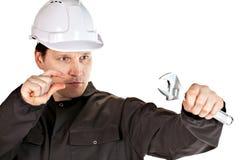 Handyman wearing uniform and hardhat Stock Image