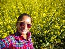 Adult Woman Taking Selfie Canola Field Alberta stock photography