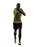 One african man referee running whistling silhouette Royalty Free Stock Photos