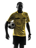 One african man referee standing holding football silhouette Stock Photography