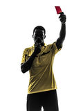 One african man referee standing showing red card  silhouette Royalty Free Stock Image