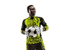 One african soccer player goalkeeper. One african male soccer player goalkeeper standing and holding ball. Silhouette isolated on white studio background royalty free stock images