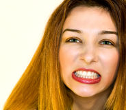 One aggressive woman showing her teeth Stock Images