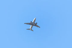 One airplane taking off on blue sky background Royalty Free Stock Photo
