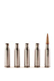 One AK bullet among shells Royalty Free Stock Photos