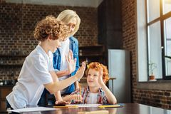 Mindful granny high fiving with two adorable grandchildren Royalty Free Stock Photography