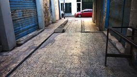 One of the alley in the center of the city of Zarqa Commercial Jordan. Usually, the heart of the city of Zerqa is crowded You may argue that the alley is empty stock photos
