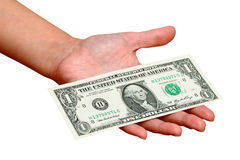 One american dollar in hand. On white background Royalty Free Stock Photo