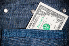 One american dollar in pocket Stock Photo