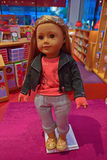 One of the American Girl characters on display in Fifth Avenue boutique shop, New York City. It is a popular but relatively expensive doll whereby clothing and royalty free stock images