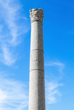 One ancient column on blue sky background Stock Image