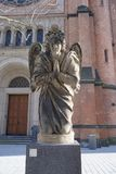 Angel in front of St. John`s Church, Dusseldorf royalty free stock image