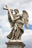 Angel with cross at the famous Sant Angelo bridge in Rome, Ital Royalty Free Stock Photo