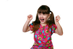 One Angry Young Child on White Background Royalty Free Stock Photography