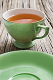 One antiques cup with tea Royalty Free Stock Photos