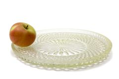 One apple on the big dish Stock Photos
