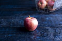 One apple on a blue background. Free space for text . royalty free stock images