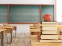 One apple on books in empty school classroom. 3d rendering. 3d rendering. one apple on books in empty school classroom. education concept Royalty Free Stock Image