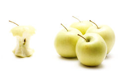 One apple core vs four whole apples Stock Images