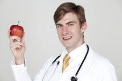 One apple a day and doctor away Royalty Free Stock Photo