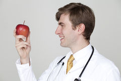 One apple a day and doctor away Royalty Free Stock Photos