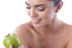 Beautiful fresh woman with green apple. Royalty Free Stock Photo