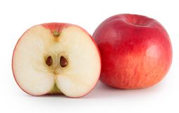 One apple and a half. One red apple and a half with seeds royalty free stock images