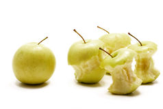 One apple vs four apple cores Stock Photography