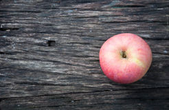 One Apple on Wooden Tabletop Royalty Free Stock Images