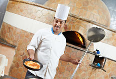 Arab baker chef making Pizza Stock Image