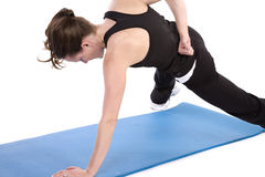 One arm push up strenghth. A woman doing a one armed push up showing off her strength Stock Image