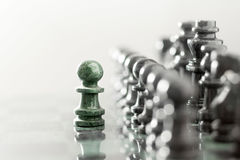The one as he is. Creative business concept photo, one pawn staying against full set of chess pieces Stock Photos