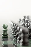 The one as he is. Creative business concept photo of pawn staying against full set of chess pieces Royalty Free Stock Photos