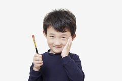 One asian boy child holds painting brush Stock Images