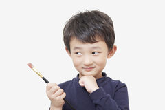 One asian boy child holds painting brush Royalty Free Stock Photo