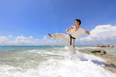 One Asian man playing with taekwondo outdoor. Royalty Free Stock Photos