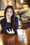 One Asian woman with smart phone royalty free stock image