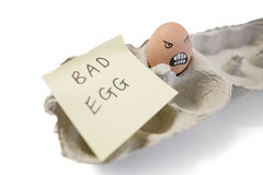One bad egg with a face drawn on it Royalty Free Stock Photos