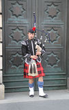 One bagpieper. One bagpiper in Edinburgh 2012 Royalty Free Stock Image