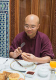 One bald man with glasses hit boiled egg for breakfast Royalty Free Stock Images