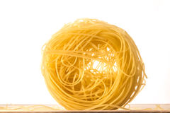 One Ball of Angels Hair Pasta on White Background Stock Photo