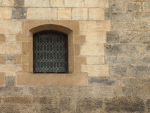 One barred window. At old stone wall Stock Photos
