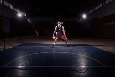 One basketball player dribble ball Stock Photos