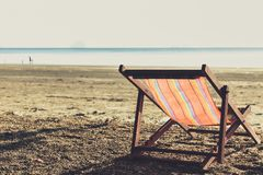 One Beach Chairs with sunset light single summer travel holiday concept Stock Images