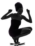 Beautiful asian young woman happy on  weight scale silhouette Royalty Free Stock Images