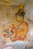 One of the beautiful frescoes at Sigiriya Rock in Sigiriya, Sri Lanka. Royalty Free Stock Photography