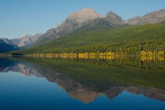 Glacier lake reflections in fall. royalty free stock images